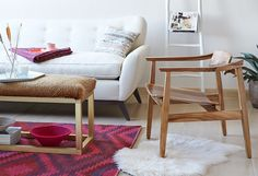 Love this modern wood chair with a pop of color in the rug.