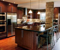 Tie in the existing ugly support column into the island and incorporate same ledgestone into backsplash and fireplace