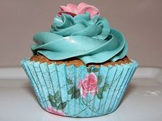 blue cupcake with pink blossom