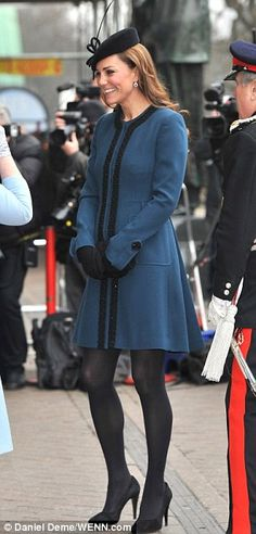 Kate wore a teal blue By Malene Birger coat for today's engagement.