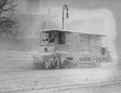 A snow sweeper trolly working during heavy snowfall on New York Streets around 1910. New York City Historical Snow Storms. Pic 5 in slideshow
