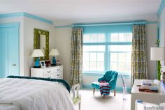 In each child's bedroom, Gilbane painted the trim a bold color. The eldest daughter chose Benjamin Moore Aura in Blue Seafoam.