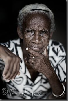 An elderly Cuban woman looks on pensively.    Keywords: Stock Photo Picture Cuba Cuban Spanish Speaking Countries Latin America Trinidad Sancti Spíritus Vertical Elderly Woman Dignity Old Serious Wrinkles Afro-Cuban Black Person Close-up White Hair Pensive Desaturated Sancti Spiritus Pensive Female Portrait