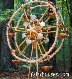 Fairy Go Round. WOW! Do you think they started with embroidery hoops? Are there pencils in there somewhere? Wish I could figure out the axle.