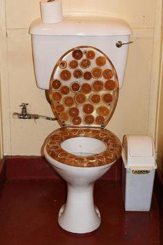 Orange Zest Toilet | 24 Totally Bizarre Decorated Toilets #bizarretoilets, #toilets
