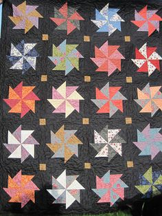 Dutch windmill quilt. I like the black background with the colorful windmills in the forefront.