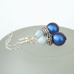 aa15205eb Swarovski® crystal pearl earrings, with deep blue pearls and blue crystal