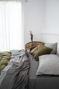 Organic Bamboo sheets with our earthy Olive linen bedding looking a dream in our studio