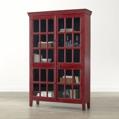 Shop Rojo Red Tall Cabinet.   Umber overtones add depth of character to the rich red finish.  The Rojo Red Tall Cabinet is a Crate and Barrel exclusive. -gorgeous