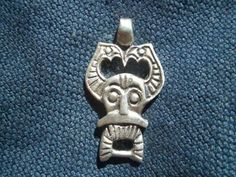 A pagan head pendant based on a find in Ribe, 8th century, Danish. .