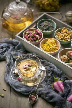 Close up image of organic assorted herbal tea ingredients; flowers and plants on wooden table top. Tee Kunst, Tea Packaging, Flower Tea, Rose Tea, Tea Art, Tea Blends, Tea Recipes, High Tea, Drinking Tea