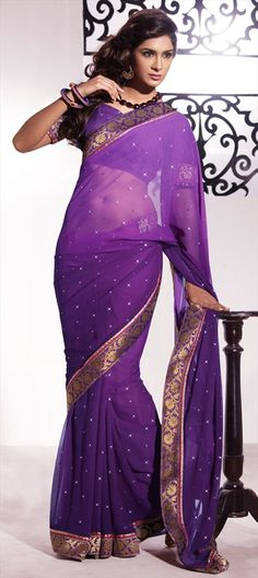 Involve Yourself with the colors of Glamour Of The Season With This Elegant Bluish Purple Chiffon Saree.