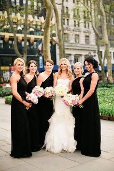 One Shoulder Black bridesmaid dresses with a hint of color in the bouquet
