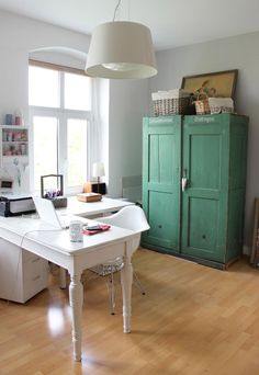 Im imagining something like this combined with one of those lovely organized craft areas only with the diy upcycled sewing cabinet (in place of the green one) in my ideal, future work room. Yes - fabric and paper will be the central focus not science textbooks!! ;)