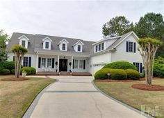 Located on the 15th green of Porters Neck Plantation sits this beautiful, 4 bedroom custom built, low country style home boasting over 4600 sq. ft.  The spacious, floor plan is ideal for hosting guests for formal occasions or just a Guy\'s Night\'\' to watch a game in the den/man cave that features a wet bar and built-ins.  The Master Suite features ample closet space, a Jacuzzi tub, dressing table, and separate shower.