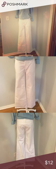 Summer staple pants! Wide leg white pants from Gap. Great summer staple - can be dressed up for business casual office or dressed down for a Sunday BBQ. Hardly worn - back pockets still stitched together!  Long length great with peep-toe wedges! Gap Pants Wide Leg