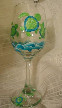 MAKES A GREAT GIFT FOR BEACH AND SEA TURTLE LOVERS! This decorative painted wine glass is painted with 3 turtles. The glass holds 20 oz. of