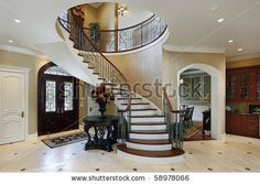 houses with circular staircases | Foyer In Luxury Home With Circular Staircase Stock Photo 58978066 ...