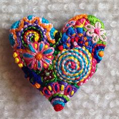 Freeform embroidery heart brooch Brooch #97 Approx. 1 1/2 wide X 1 1/2 tall.  Many bright colors make this heart so much fun! I have stitched for many