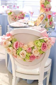 Flowers on the back of chairs make a perfect addition to a summer garden wedding reception #wedding #summer #garden