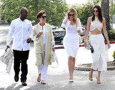 Corey Gamble, Kris Jenner, Khloe Kardashian and Kendall Jenner leave a West Hills church after Sunday morning Easter service