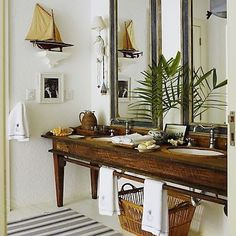A rod across in front of sinks -- what an idea for hand towels!   British Colonial Design - Africa + Plantation ...
