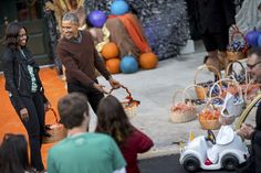 The president just couldn't deal with how cute the kid's costume was.