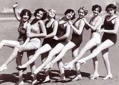 Ladies doing a goofy kickline in the 1930s.