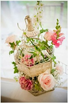 Wedding Table Decorations: Birdcages and Pink Flowers