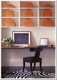 color in a bookcase with stacked boxes