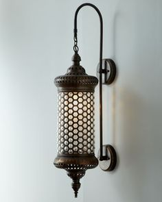 """Moroccan"" Metal Sconce at Horchow.  Reminds me of beehives and although it is decorative I love the idea of mixing it with modern..."