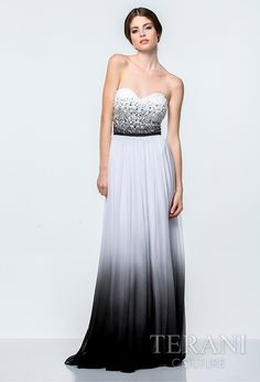 Strapless prom gown with sweetheart neckline and two-tone embellishemnt over the bodice, the dress is finished with complimentary ombre on the flowing mesh skirt and black satin belt at the waist. Love the ombre effect!