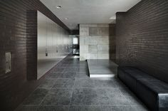 The House of Silence in Shiga, Japan looks very different than the ordinary homes on this small street. Rather than being inspired by thesurroundinglandscape, this home turns its back to the street and focuses on its inner environment. Designed by FORM/Kouichi Kimura Architects, the exterior is formed of massive slabs of concrete and dark bricks.The two story structure is composed of several split level rooms with varying ceiling heights. The interior features built in furniture and a…