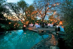 Between the trees, lighting, the possibilities with the pool.. a wonderful Fall wedding spot!