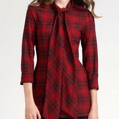 Alice & Olivia Top Super cute red and black plaid top. Only worn once and I'm only selling it because my torso is too short for this look. I would recommend this shirt for girls that are taller than me! I'm 5'2. Alice + Olivia Tops Button Down Shirts