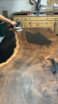 Black Epoxy Walnut Table Buffering in the finishing oil on this gorgeous table before she ships to Michigan! The post Black Epoxy Walnut Table appeared first on Woodworking Diy. Epoxy Wood Table, Epoxy Resin Table, Epoxy Table Top, Wood Slab Table, Diy Epoxy, Wood Tables, Woodworking Furniture Plans, Woodworking Projects, Woodworking Videos