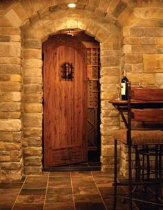 Doors and Windows -- Custom Wine Cellar Door maintains temperature and looks appropriate