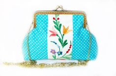 A piece of Hungarian style needle work, called 'kalocsai'  was mixed with light blue polka dot pattern for this clutch bag.As needleworks are never the same there might be a bit of difference in the flower pattern. But I will send you photos so that you can see the embroidery in advance.Size: 13 x 19 cm