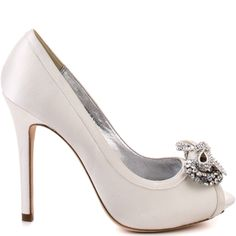 Whether you're the bride or just the attendee, you'll be a vision of pure grace.  Bourne brings you Kathryn, a simple yet sophisticated 4 inch pump covered in a luxe ivory satin.  A 1/2 inch platform adds to the beautiful stones that cover the double bow vamp.  This elegant style will be the perfect addition to your special occasion.
