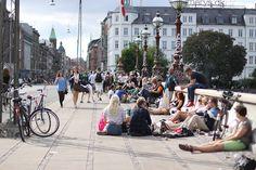 People gathering on Bronning Louises bro sidewalk in Copenhagen.