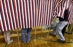 """FILE - In this Nov. 8, 2016 file photo, a voter enters a booth at a polling place in Exeter, N.H. Tweets alone don't make it true. Donald Trump won the presidency earlier this month even as he lost the popular vote to Democrat Hillary Clinton, according to The Associated Press's vote-counting operation and election experts. Trump nonetheless tweeted on Nov. 26 that he won the popular vote. and alleged there was """"serious voter fraud"""" in California, New Hampshire and Virginia…"""