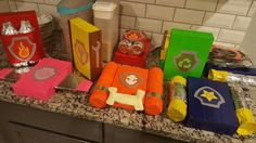 DIY pup packs made with recycled water bottles, boxes and colored duct tape Paw Patrol Kostüm, Paw Patrol Masks, Rubble Paw Patrol, Paw Patrol Party, Paw Patrol Birthday, Paw Patrol Halloween Costume, Teacher Halloween Costumes, First Halloween, Holidays Halloween