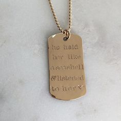 Gold Dog Tag Necklace // www.nellenetree.com // He held her like a seashell and listened to her heart.