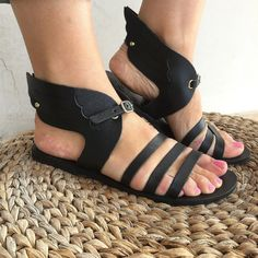 Winged ancient greek sandals in black & natural leather