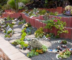 Place your miniature garden in an easily accessible location. Here, the village runs along the top of a knee-high block wall that elevates it for good viewing and makes it easy to reach into and putter with. Then, form hills and valleys to vary the landscapes by mounding or excavating soil, or creating terraces that add dimension.