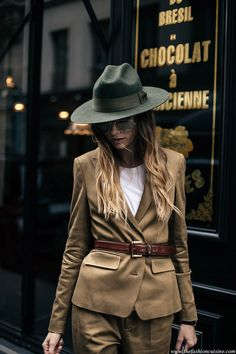 Fashion blogger Beatrice Gutu during Paris Fashion week in a mustard suit and khaki fedora hat outfit ideas