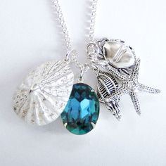ALL ABOUT HONEYMOONS - Check us out on Facebook!  https://www.facebook.com/AAHsf  Rockpool Necklace. Swarovski crystal and sterling silver sea shells, starfish and crab charms.