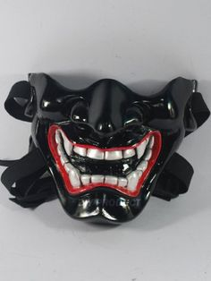 Japanese Hannya Evil Mask (Half Cover) , ?Black Kabuki Airsoft Mask and Prop Mask Airsoft mask,http://www.amazon.com/dp/B008ASA5I6/ref=cm_sw_r_pi_dp_PEzcsb1QZC71ZP11