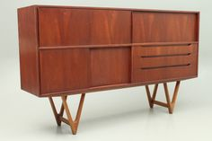 Credenza in teak with the characteristic oak legs designed by Kurt Østervig and manufactured by K.P.Møbler, Denmark. www.reModern.dk