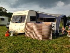 Tin Box pitched up under dark skies in #Dorset - #caravan #blog